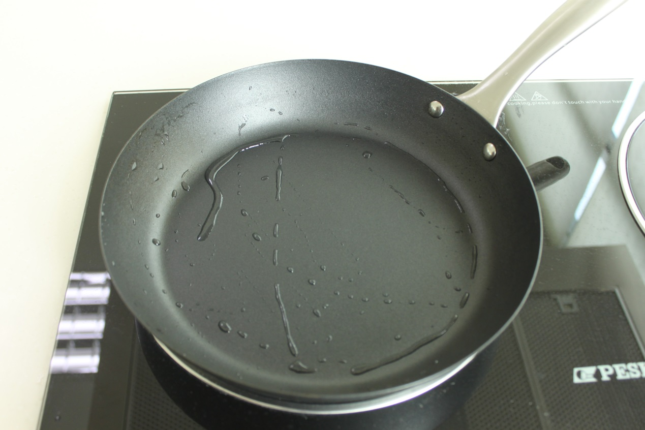 Drying a Lotus Rock frying pan on the stove